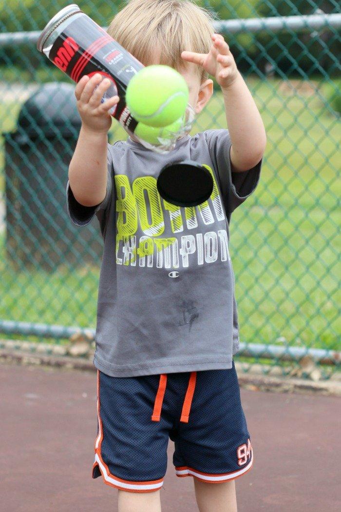J tossing tennis balls