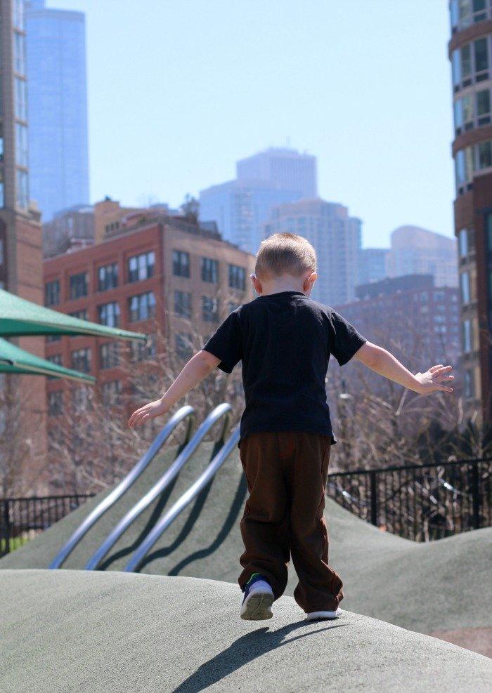little boy walking on playground