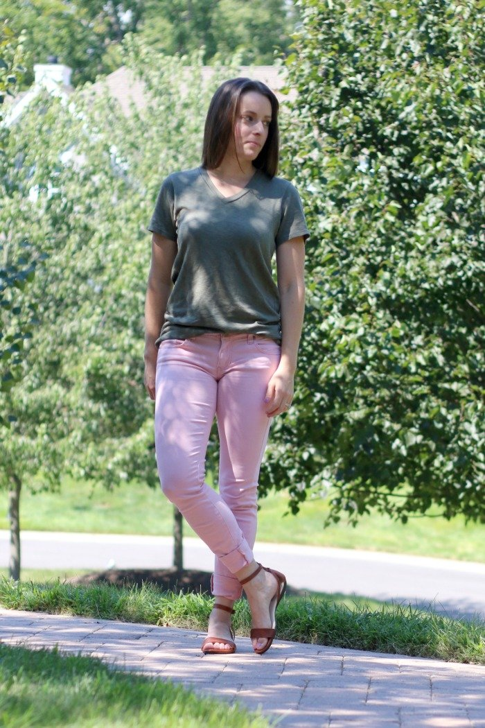 pink-jeans-and-olive-tshirt-on-a-woman