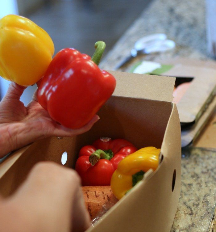 red and yellow peppers in a Hello Fresh box