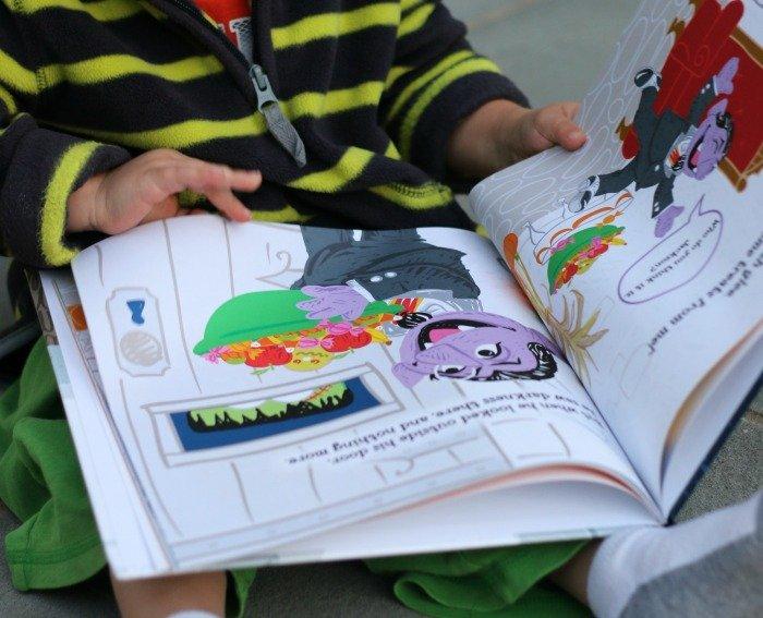 little-boy-flipping-through-halloween-pages-book