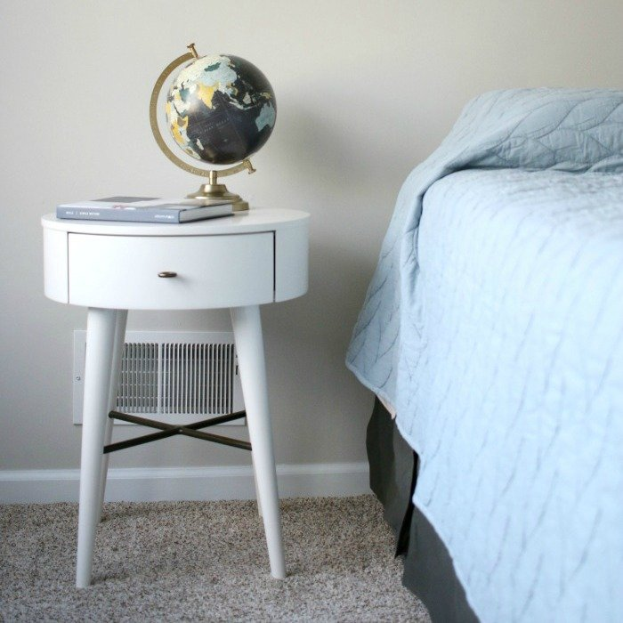 nightstand-with-globe-and-book-next-to-bed-square