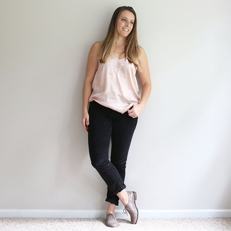 woman in camisole with black corduroy pants