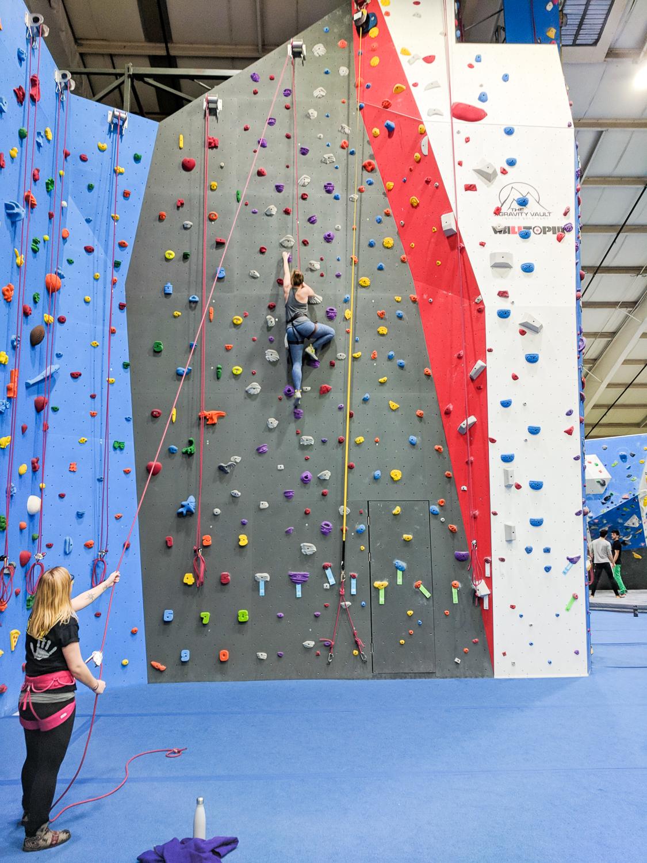woman doing indoor rock climbing